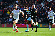 Referee Lee Mason allows play to continue for Fulham FC midfielder Scott Parker (8) during the EFL Sky Bet Championship match between Fulham and Queens Park Rangers at Craven Cottage, London, England on 1 October 2016. Photo by Jon Bromley.