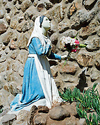 "Female statuette kneels in devotion in South Texas grotto. NOTE: Click ""Shopping Cart"" icon for available sizes and prices. Doing so does not constitute making a purchase. To purchase, additional steps are required."
