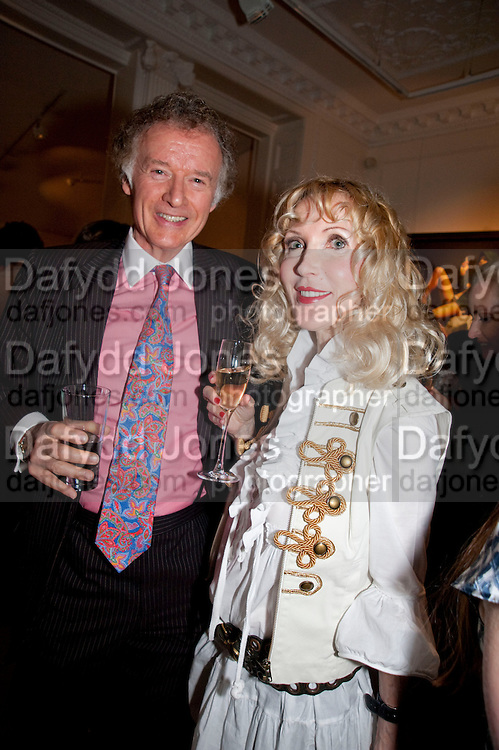 RICHARD BRIGGS; BASIA BRIGGS, Opening of 'The Promised Land' Exhibition of work by Mitch Griffiths. Halcyon Gallery. Bruton St. London. 28 April 2010 *** Local Caption *** -DO NOT ARCHIVE-© Copyright Photograph by Dafydd Jones. 248 Clapham Rd. London SW9 0PZ. Tel 0207 820 0771. www.dafjones.com.<br /> RICHARD BRIGGS; BASIA BRIGGS, Opening of 'The Promised Land' Exhibition of work by Mitch Griffiths. Halcyon Gallery. Bruton St. London. 28 April 2010