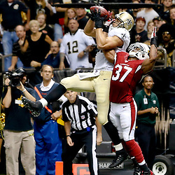 Sep 22, 2013; New Orleans, LA, USA; New Orleans Saints tight end Jimmy Graham (80) catches a touchdown over Arizona Cardinals strong safety Yeremiah Bell (37) during the first half of a game at Mercedes-Benz Superdome. Mandatory Credit: Derick E. Hingle-USA TODAY Sports