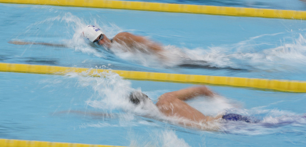 Swimmers (Bottom to Top) David Davies of Great Britain and Sebastian Rouault of France compete in the fourth heat of the men's 800m Freestyle at the FINA World Championships in Montreal, Canada Tuesday 26 July, 2005.