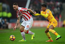 Marko Arnautovic of Stoke City battles for the ball with Patrick van Aanholt of Crystal Palace - Mandatory by-line: Alex James/JMP - 11/02/2017 - FOOTBALL - Bet365 Stadium - Stoke-on-Trent, England - Stoke City v Crystal Palace - Premier League