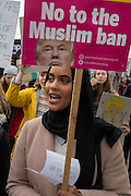 A young Muslim woman protests at the Stop Trump's Muslim ban demonstration on 4th February 2017 in London, United Kingdom. The protest was called on by Stop the War Coalition, Stand Up to Racism, Muslim Association of Britain, Muslim Engagement and Development, the Muslim Council of Britain, CND and Friends of Al-Aqsa. Thousands of demonstrators gathered to demonstrate against Trump's ban on Muslims, saying it must be opposed by all who are against racism and support basic human rights, and for Theresa May not to collude with him.