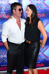 Image ©Licensed to i-Images Picture Agency. 27/08/2014. London, United Kingdom. Simon Cowel with Lauren Silverman arriving for the launch of the new series of The X Factor. Picture by Nils Jorgensen / i-Images