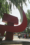 Eight years after Tajik independence was declared, in 1991, from the Soviet Union a hammer and sickle monument still stands in the Khojand market place, Tajikistan.