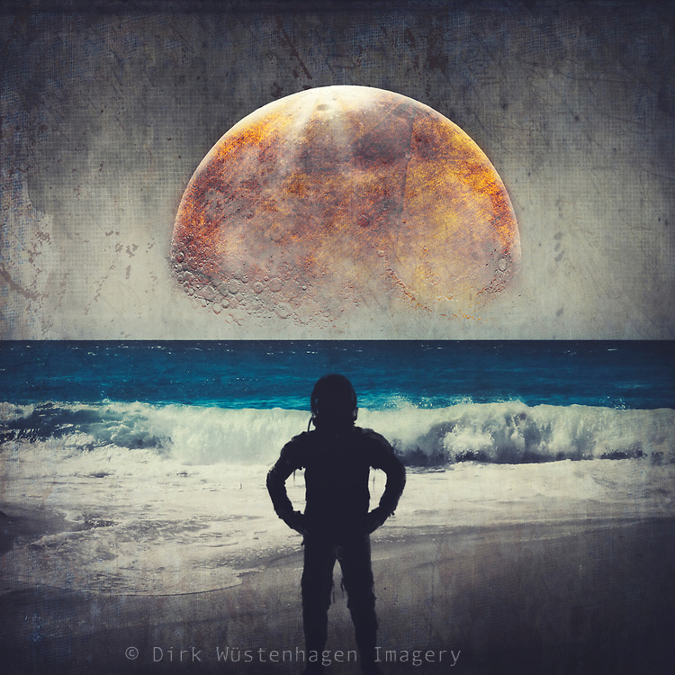 Astronaut standing on a beach with a Moon like object in the sky - photomanipulation