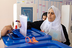 LNP Weekly Highlights 02/05/14. FILE PICTURE. © Licensed to London News Pictures. 30/04/2014. Sulaimaniya, Iraq. An elderly Kurdish Iraqi woman places her voting slip into a ballot box during the 2014 Iraqi parliamentary elections in Sulaimaniya, Iraqi-Kurdistan today (30/04/2014). . <br />