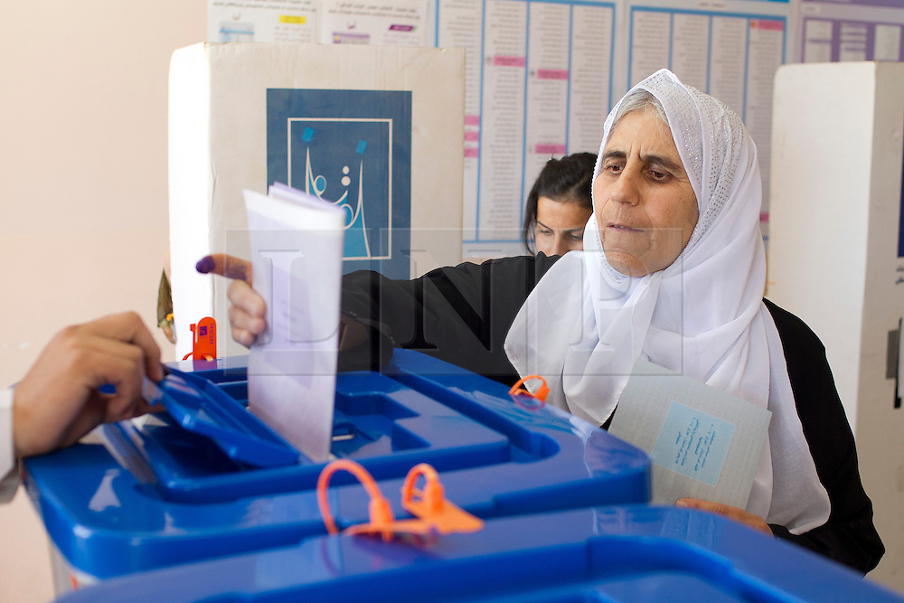 LNP Weekly Highlights 02/05/14. FILE PICTURE. © Licensed to London News Pictures. 30/04/2014. Sulaimaniya, Iraq. An elderly Kurdish Iraqi woman places her voting slip into a ballot box during the 2014 Iraqi parliamentary elections in Sulaimaniya, Iraqi-Kurdistan today (30/04/2014). . <br /> <br /> The period leading up to the elections, the fourth held since the 2003 coalition forces invasion, has already seen polling stations in central Iraq hit by suicide bombers causing at least 27 deaths. Photo credit: Matt Cetti-Roberts/LNP