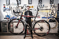 Pictured working inside Soigneur bike shop in Copenhagen is co-owner Jacob Lindsel. The store provides high quality bikes and equipment to serious riders, especially those who take part in the sport of Cyclocross.