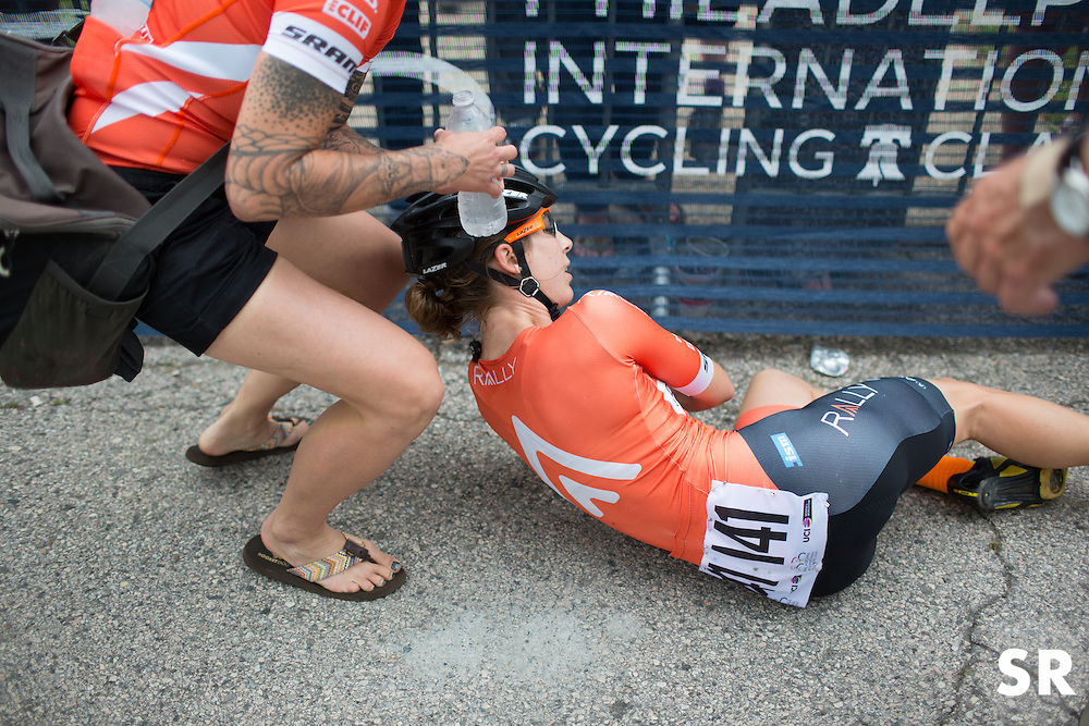 Heather Fischer (USA) of Rally Cycling Team collapses after a hard effort after finishing the Philadelphia International Cycling Classic, a 117.8 km road race in Philadelphia on June 5, 2016 in Philadelphia, PA.
