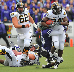 Nov 14, 2009; Manhattan, KS, USA; Missouri running back Derrick Washington (24) is brought down by Kansas State defensive back Emmanuel Lamur (23) in the first quarter at Bill Snyder Family Stadium. The Tigers won 38-12. Mandatory Credit: Denny Medley-US PRESSWIRE