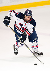 March 13 2016: Robert Morris Colonials defenseman Eric Israel (8) skates with the puck during the first period in game three of the Atlantic Hockey quarterfinals series between the Bentley Falcons and the Robert Morris Colonials at the 84 Lumber Arena in Neville Island, Pennsylvania (Photo by Justin Berl)