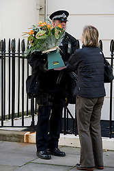 ©  London News Pictures. 13/10/2012. London, UK. Flowers being left with police outside the home of Former British Prime Minister Margaret Thatcher  on her 87th birthday  on October 13, 2012. Photo credit : Ben Cawthra/LNP