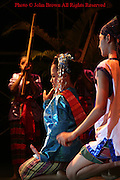 Men and women wearing traditional Thai costumes are performing at the Krabi Dance Festival in Krabi, Thailand.