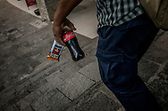Man carries away American processed food and a bottle of artificially-sweetened soft drink from a convenience store one morning.  Puerto Vallarta, Mexico.  In some convenient stores, imported soft drinks cost the same or even less than bottled water in a country where much of tap water is not safe to drink.<br /> <br /> Post-NAFTA, cheap American processed foods from multinational giantsfrom the agriculture and food production industry flood into Mexico transforming the food system, triggering a crisis in obesity and a rapid rise in the occurrence of diabetes.