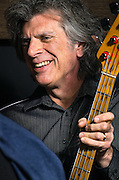 Roy Fisher on bass between songs while performing with Scott McClatchy at The Bus Stop Music Cafe.