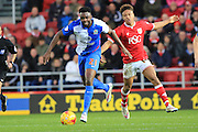 Blackburn Rovers midfielder Hope Akpan and Bristol City midfielder Bobby Reid during the Sky Bet Championship match between Bristol City and Blackburn Rovers at Ashton Gate, Bristol, England on 5 December 2015. Photo by Jemma Phillips.
