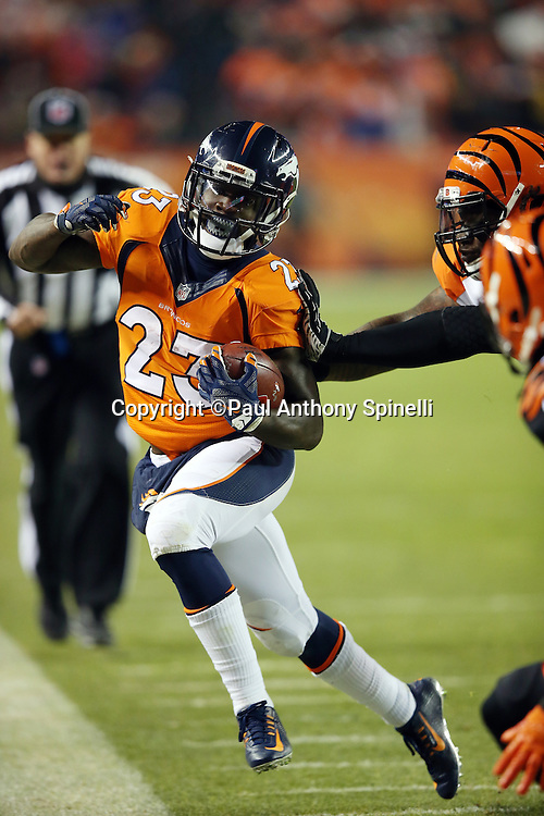 Denver Broncos running back Ronnie Hillman (23) gets shoved out of bounds by a defender after catching a second quarter pass for a gain of 14 yards and a first down to the Cincinnati Bengals 7 yard line with less than two minutes left before halftime during the 2015 NFL week 16 regular season football game against the Cincinnati Bengals on Monday, Dec. 28, 2015 in Denver. The Broncos won the game in overtime 20-17. (©Paul Anthony Spinelli)