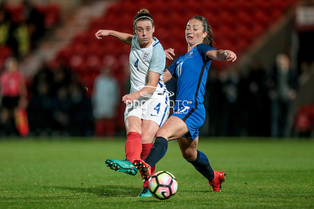 Jade Moore (England) passes the ball forward past Gaetane Thiney (France) during the International Friendly match between England Women and France Women at the Keepmoat Stadium, Doncaster, England on 21 October 2016. Photo by Mark P Doherty.