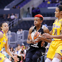 25 May 2014: San Antonio Stars guard Danielle Robinson (13) drives past Los Angeles Sparks guard Lindsey Harding (10) during the Los Angeles Sparks 83-62 victory over the San Antonio Stars, at the Staples Center, Los Angeles, California, USA.