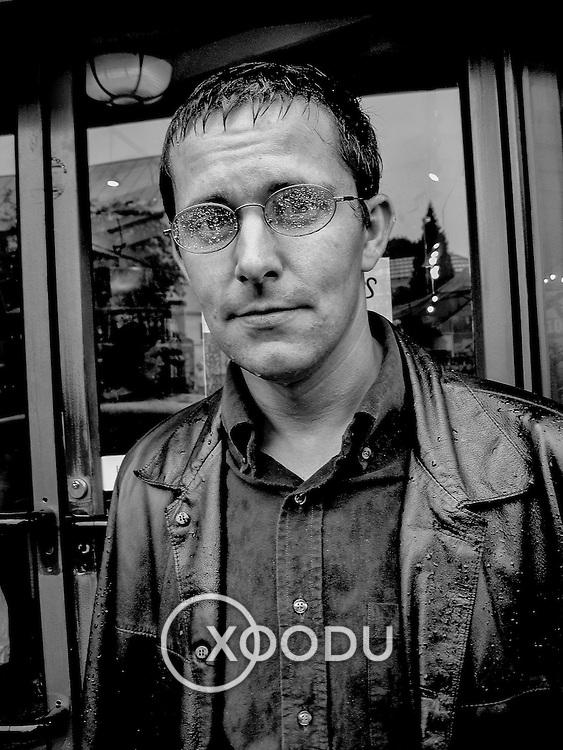 Wet, miserable looking man, Cambridge, England (June 2004)