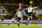 Burnley defender Michael Keane  heads the ball away from Derby County forward Chris Martin  and Derby County forward Johnny Russell  during the Sky Bet Championship match between Burnley and Derby County at Turf Moor, Burnley, England on 25 January 2016. Photo by Simon Davies.