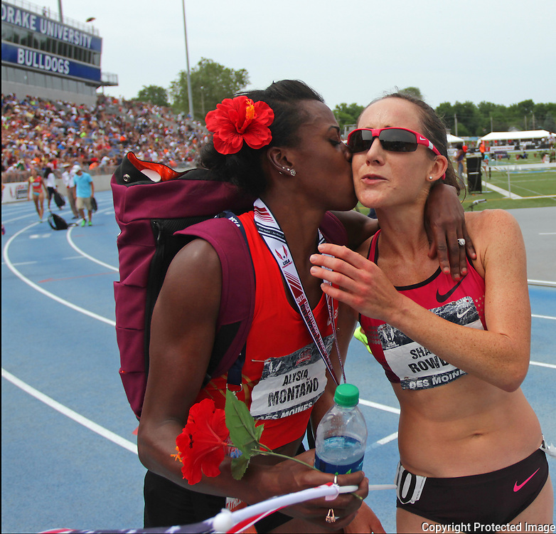 MONTANO.ROWBURY - 13USA, Des Moines, Ia.  - Alysia Montano gives Shannon Rowbury a kiss after Rowbury qualified for the World Championship team with a third place finish in the 5,000. Montano made the team with a win in the 800.  Photo by David Peterson