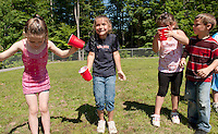"At Elm Street School's Alice in Wonderland themed Field Day it was tea on ""top of their heads"" for Jewel Simmons, Haley Richter and Madeline Gautreau during Mad Hatter's Tea Party Tuesday morning.  (Karen Bobotas/for the Laconia Daily Sun)"
