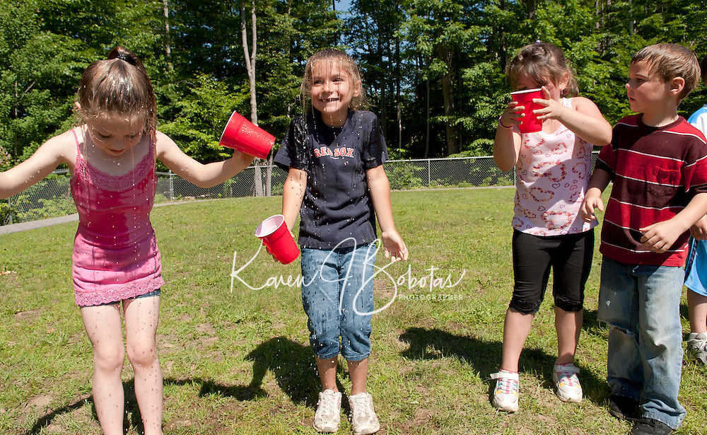 """At Elm Street School's Alice in Wonderland themed Field Day it was tea on """"top of their heads"""" for Jewel Simmons, Haley Richter and Madeline Gautreau during Mad Hatter's Tea Party Tuesday morning.  (Karen Bobotas/for the Laconia Daily Sun)"""
