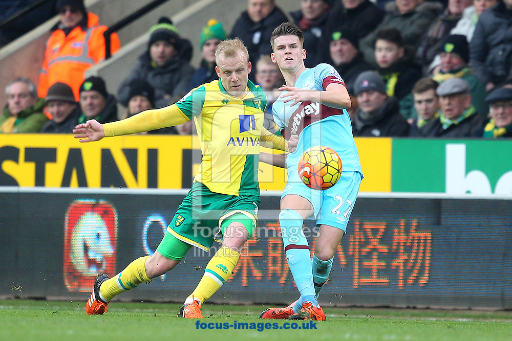 Sam Byram of West Ham and Steven Naismith of Norwich in action during the Barclays Premier League match at Carrow Road, Norwich<br /> Picture by Paul Chesterton/Focus Images Ltd +44 7904 640267<br /> 13/02/2016