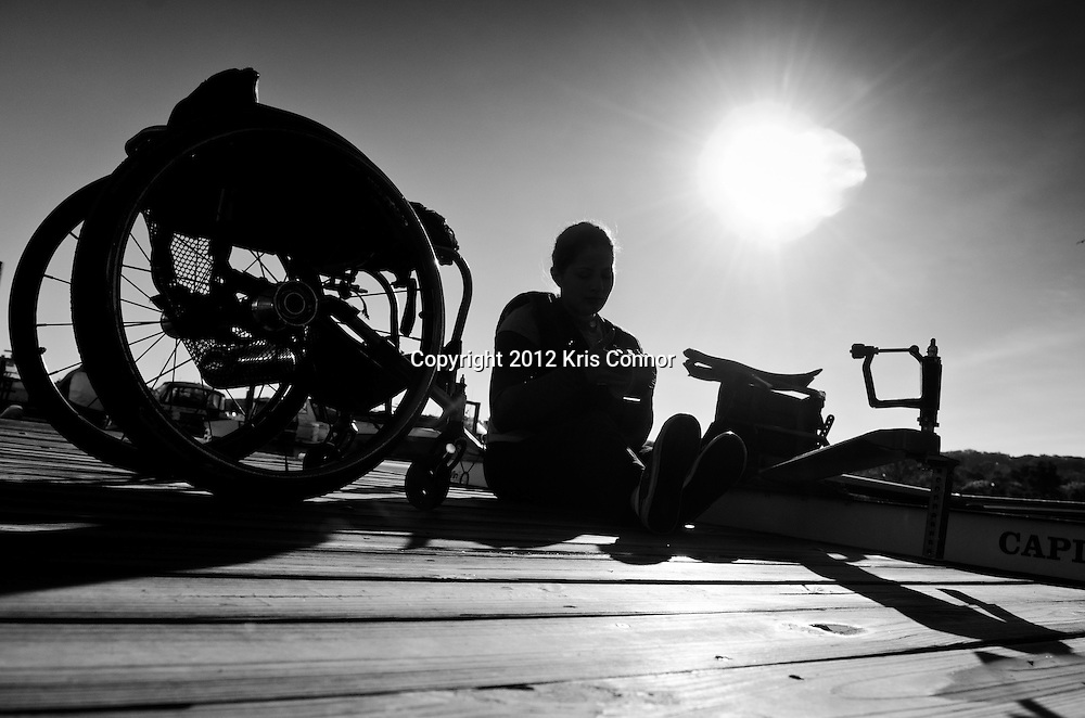 Dana moves from her wheelchair to the dock as she prepares to get into her shell before a morning practice at the boat house on October 13th.