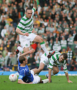 Celtic's Scott Brown hurdles Rangers' Steven Whittaker during the League Cup final between Rangers and Celtic at Hampden Park -<br /> David Young Universal News And Sport