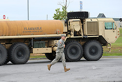 A Georgia National Guard soldier runs past his fuel truck as his unit scrambles to get to a staging area off I-75 North with Hurricane Irma approaching on Sunday, September 10, 2017, in Cordele, Ga. Photo by Curtis Compton/Atlanta Journal-Constitution/TNS/ABACAPRESS.COM