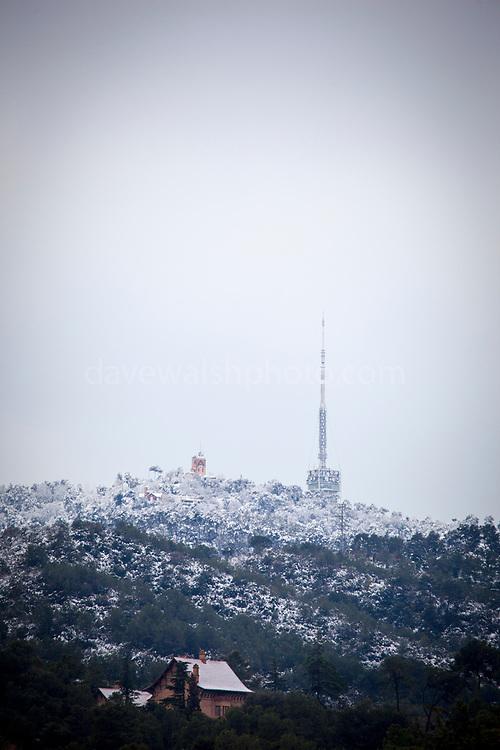 Snow on the Norman Foster designed Torre de Collserola at Tibidabo, and surrounding Parc Collserola, Barcelona