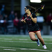 23 March 2018: San Diego State midfielder Harlowe Steele brings the ball towards the net in the first half. The Aztecs beat the Lady Flames 11-10 Friday night. <br /> More game action at sdsuaztecphotos.com