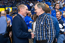 Former UK President Lee Todd, right greeted by current UK President Eli Capilouto during halftime of the University of Kentucky game versus the LSU Tigers, Saturday, March 05, 2016 at Rupp Arena in Lexington .