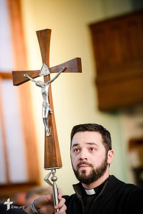 SMP Vicar Tyler Cronkright carries the processional cross during the chancel dedication service at Family of God on Wednesday, March 28, 2018, in Detroit. LCMS Communications/Erik M. Lunsford