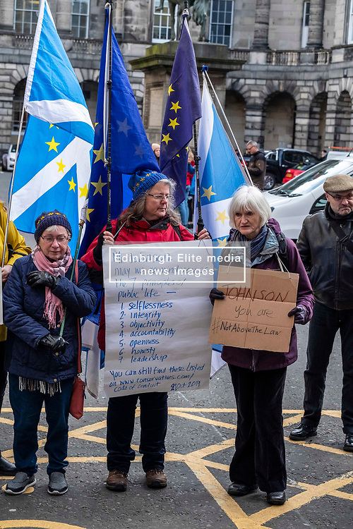 Pictured: Protestors were on hand to hear the judgement<br />