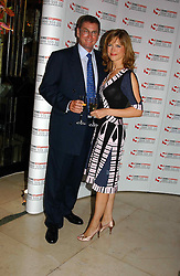 """TV presenter KATIE DERHAM and LORD ASHCROFT at a party to celebrate the publication of Bruce Oldfield's autobiography """"Rootless"""" held in aid of Crimestoppers at Claridge's, Brook Street, London W1 on 22nd September 2004.<br /><br />NON EXCLUSIVE - WORLD RIGHTS"""