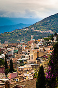 Hillside houses and churches, Taormina, Sicily, Italy