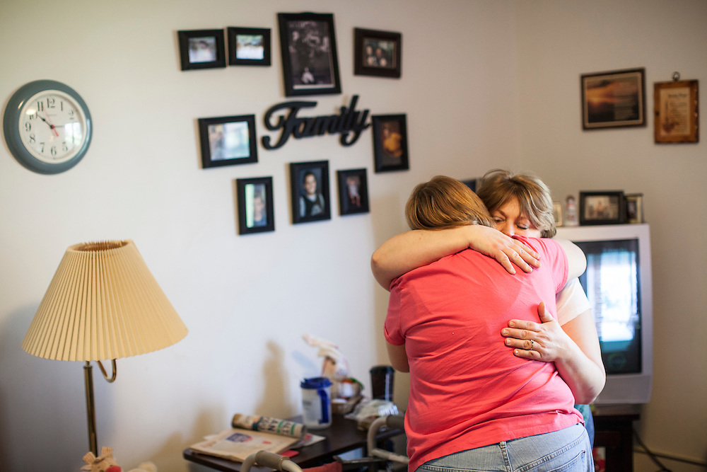 Sheila Hilpipre hugs her mother Ella Graff on Saturday, March 24, 2012 in Webster City, IA.