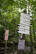 Hiking signposts on the climb up to Sarnia Skala, a mountain in the Tatra National Park, on 16th September 2019, near Koscielisko, Zakopane, Malopolska, Poland.