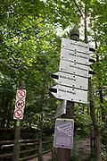 Hiking signposts on the climb up to Sarnia Skala, a mountain in the Tatra National Park, on 16th September 2019, near Koscielisko, Zakopane, Malopolska, Poland.
