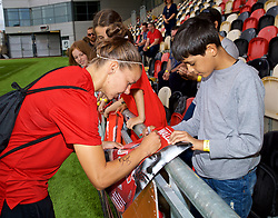 NEWPORT, WALES - Thursday, August 30, 2018: Wales' Loren Dykes signs autographs for young supporters after a training session at Rodney Parade ahead of the final FIFA Women's World Cup 2019 Qualifying Round Group 1 match against England. (Pic by David Rawcliffe/Propaganda)