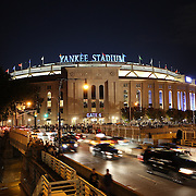 An exterior view of Yankee Stadium at night during the New York Yankees V Tampa Bay Rays Baseball game at Yankee Stadium, The Bronx, New York. 26th September 2013. Photo Tim Clayton