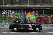 """The face of Saudi Crown Prince Mohammed bin Salman on the side of two black cabs in Shoreditch, 7th March 2018, in east London England. Industry sources said the Saudis could be spending close to £1m on the campaign, which includes dozens of prime poster sites around London and newspaper ads. """"He is bringing change to Saudi Arabia,"""" the ads say, with a large photo of Crown Prince Mohammed bin Salman and the hashtag #ANewSaudiArabia."""