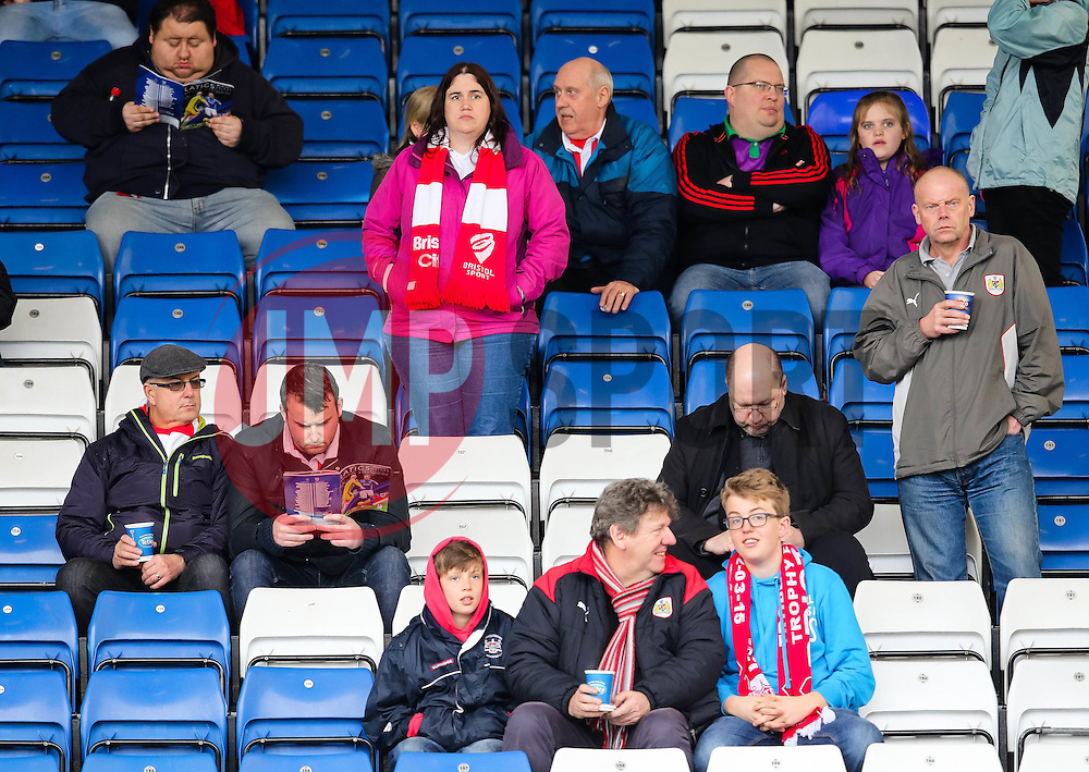 Bristol City fans check their programmes ahead of kick off  - Photo mandatory by-line: Matt McNulty/JMP - Mobile: 07966 386802 - 03/04/2015 - SPORT - Football - Oldham - Boundary Park - Oldham Athletic v Bristol City - Sky Bet League One