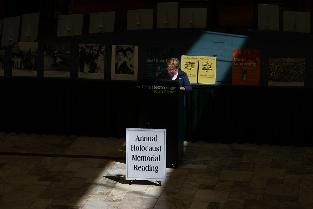 "Margot Jogwick announces the names of those who were murdered in the Holocaust during the 24th Annual ""Unto Every Person There Is a Name"" Holocaust Memorial Program at the Charleston Town Center Mall. in Charleston, W.V., on Thursday, April 12, 2018. Jogwick was born in 1934, and lived in the Jewish Quarter of Berlin despite not being jewish herself. She was a witness to kristallnacht and lived in Berlin for the entire duration of the war; seeking shelter in bunkers with her family during the Battle of Berlin in April 1945, which ended with Hitler's suicide and the surrender of Nazi Germany. ""It looked like Syria. Everything was rubble"" she said. She lived in the Soviet sector of Berlin until 1958 when she emigrated to the United States."
