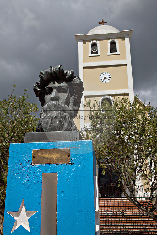 The Monumento a Betances honoring rebel leader Ramon Emeterio Betances in front of the Spanish Colonial style church Iglesia de Parroquia San Jose de la Montana in the Plaza de la Revolucion in Lares, Puerto Rico. Lares is where the 1868 revolt began.