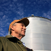 Bill Johnson represents the fourth generation that has farmed his family run farm, purchased by his great grandfather in 1887.  Johnson has farmed most of his life, starting as a teenage boy in Shelby County, Iowa.  One of his largest storage bins (behind Johnson) holds 27,000 bushels of corn..  Photo by David Peterson